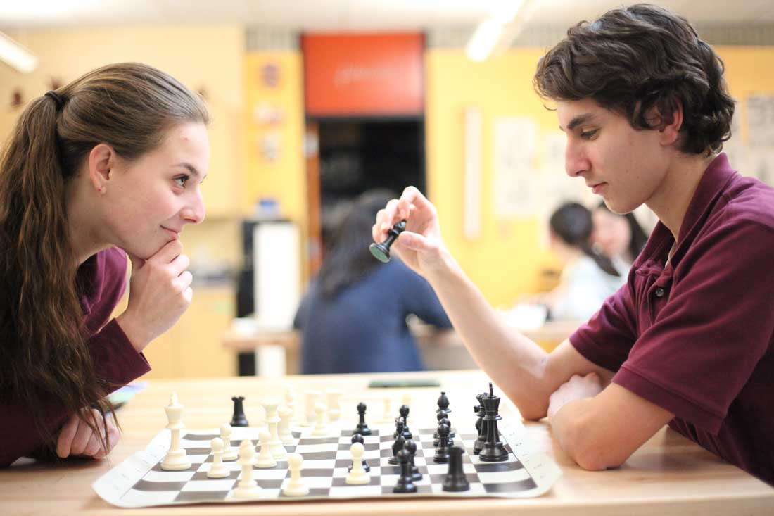 Students face off during Chess Club.