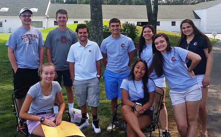 Group of nine student volunteers at the Golf Classic.