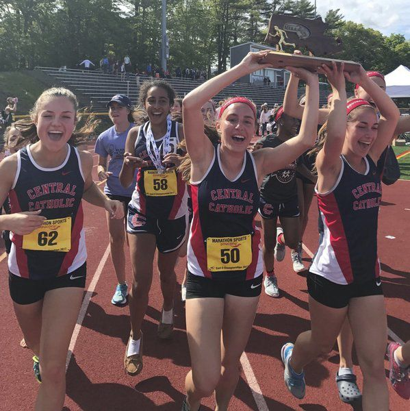 Julia Worden (#62 at left) and the Central Catholic girls track team last spring after winning the EMass. DIvision 2 title. From left, Julia Worden '18, Janessa Nault '19, Julia Jankowski '17, and Kierstin Lock '17.
